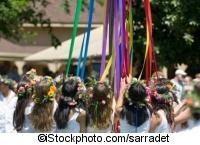 Children dancing around a maypole